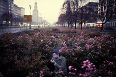 Torsun Burkhardt takes a cigarette among the flowers along Frankfurter Allee in Friedrichshain, Berlin on November 8, 2011 by Mustafah Abdulaziz