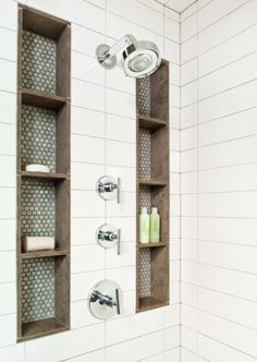 Tall shower niches. Blue, brown, and subway tile.