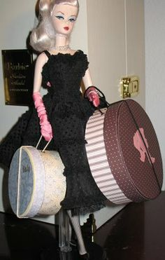 Barbie and hat boxes....made these hat boxes from round paper mache boxes, eyelets, scrapbooking paper, acrylic paint, and yarn. Measure the circumference of your hat, buy the appropriate size box, and then use a Dremel or saw to cut it down to the right height. The yarn is woven through the eyelets in such a way so that it tightens on the lid when the handle is pulled.