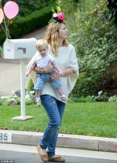 Practical: Keeping it suitably casual in a pair of stonewash jeans and a cream jumper, the acclaimed screen star certainly cut a maternal figure as she carried her 11-month-old , Frankie, into the street for some respite