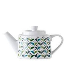 Retro Teapot The bold teal and turquoise color palette modernize a pattern that could have been pulled from Grandma's kitchen back in the 1950s.