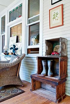 Wooden boxes that had been scattered around the front porch were stacked, making a boot/shoe nook.