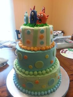 Little monsters baby shower cake