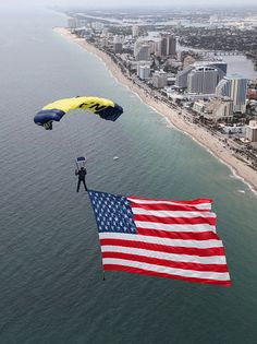 A SEAL on the U.S. Navy parachute demonstration team, the Leap Frogs, flys an 800-square-foot American flag during a rehearsal for the Lauderdale Air Show.    FORT LAUDERDALE, Fla. (April 27, 2012)