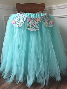 A personal favorite from my Etsy shop https://www.etsy.com/listing/274331354/tutu-skirt-highchair-banner-first