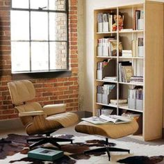 Light leather colour Eames reading chair. Reading corner.