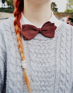 bow ties  sweaters  That made my day!!!!!! Much as UI love tucked in shirts or blouses with bowties,this look has me.
