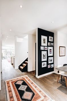 Love the dark wall and white frames to really make a wall gallery pop! Perfect way to make a small out of place wall feel like a work of art. Accent Wall Bedroom, Black Accent Walls, Black Walls, Wall Accents, Apartment Design, Apartment Therapy, Dream Apartment, Gallery Walls, Modern Gallery Wall