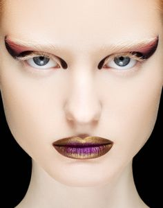 I love the use of Dark & Light makeup and i think that the gold lips would be very futuristic for my character