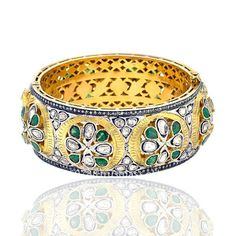 Ugly! Change out the Emeralds for Rubies and I would love this ring. LD.