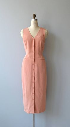 Vintage 1990s clay pink silk sleeveless dress with button front, sheath shape, hip pockets and full lining. --- M E A S U R E M E N T S --- fits like: large bust: 40-42 waist: 32-34 hip: 44 length: 50 brand/maker: Patrick Collection condition: excellent to ensure a good fit, please read the sizing guide: http://www.etsy.com/shop/DearGolden/policy ✩ more vintage dresses ✩ http://www.etsy.com/shop/DearGolden?section_id=5986725 ✩ visit t...