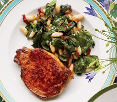 I never make greens. This sounds so good!  Pork Chops With Chard and White Beans