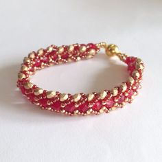 Red and gold flat spiral bracelet by La pietra blu di Avalon