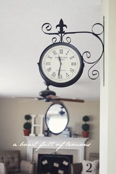 Love this vintage-look train station clock, like the mantle decor in the background too