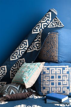 Blue and white accents are hot this summer! Surya has pillows, poufs, and rugs to match your style home.