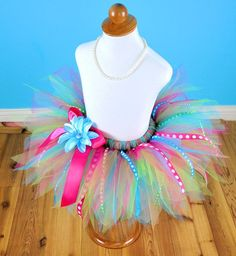 simple DIY.  elastic for the waist.  tie on lengths of tulle and ribbons.