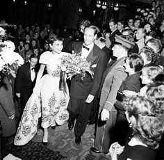 Audrey Hepburn and Mel Ferrer attend the Netherlands' premiere of Sabrina, November 1954. Audrey Hepburn is wearing the same Givenchy ball gown that she wore in the film. Photograph by Jack Garofalo.