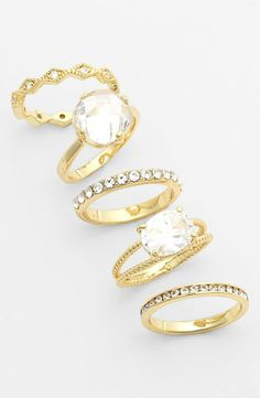 Love! Set of 5 sparkly mixed stackable rings.