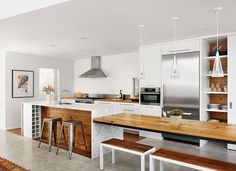 Alter integrated wood from the original bungalow into the kitchen and covered the island in Carrara marble.