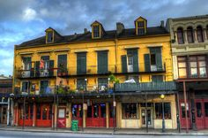 Early morning photograph of one of the many beautiful buildings along Decatur Street in the French Quarter of New Orleans. This building is home to Langford Market, Big Easy Daiquiris and Java House Imports.