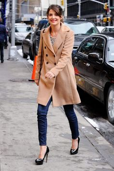 Cobie Smulders in carmel coat, Breton stripes, skinnies, heels and a slash of red lipstick
