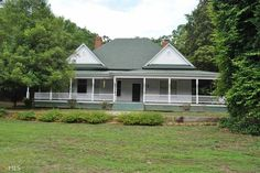 If a historic southern home on 3.5 acres is what you are after that you can renovate to make you own then the is the home for you! Wrap around porch, antique barns, all of the 1890's charm is still intact, this home sits off the road a bit and would be perfect for a family gathering. Don't let this home pass you by as this kind of home for this price doesn't come up too often in this sought after part of the county.