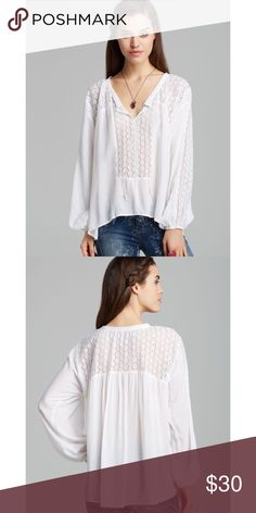 Free People Moon River Top No flaws to mention. Hippie-chic styling is made easy with this peasant blouse from Free People. The lace detailing and a keyhole tie neckline are cute and feminine finishing touches. Round drawstring neckline with split keyhole tie. Long sleeves with elasticized cuffs. Lace detailing along sleeves, front and back yoke. Hi-lo hemline. 100% rayon. Machine wash. Color: white. Free People Tops Blouses