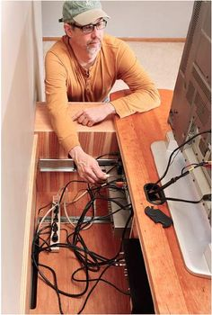 Slide-Out-Cabinet-Design - even with tv wall mounted, a great plan for access to electronics