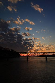 Looking out past O'Neil Bridge as the sun sets on the Tennessee River in Florence. February 15, 2009 in Alabama, USA.
