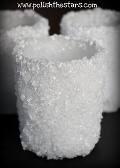 Snowball Candleholders: Use a paint brush to apply mod podge. Sprinkle on some Epsom salt (found in the first aid section) and allow to dry.  Brush on a second coat of mod podge and more Epsom salt. The salt gives gives a little sparkle and enough coverage that battery operated tealights look like real flames.
