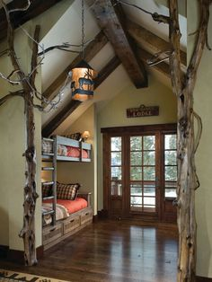 Natural timber corner protection on interior walls. Could leave a branch or two for coats.