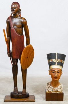 Lot 192: Carved Wood Maasai Warrior Tribal Statue; Unmarked carved and painted wood male warrior with shield and spear; together with a Berlin museum plaster copy of an Egyptian Nefertiti bust
