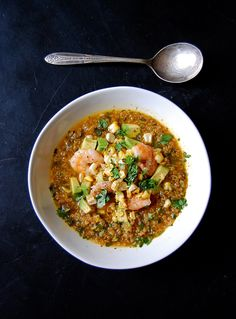 Cilantro & Quinoa Soup  1 cup quinoa, rinsed   4 cups vegetable stock, plus additional water as needed   1 large bunch cilantro [yield about 1 cup chopped]   3 small (or 1 large) red onions, thinly sliced   4 garlic cloves, minced   Olive oil  Sea salt   Black pepper   Fresh lime juice, from 1/2 lime   Ground coriander, to taste   Pinch cayenne pepper