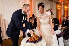 Cutting the challah found on Modern Jewish Wedding Blog // Photographer:  Michael Novo Photography