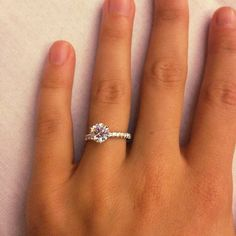 My engagement ring! 1.5 carat round solitaire center diamond with .5 carat skinny diamond band set in platinum