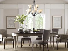 Bravo Collection: a current, truly transitional style is achieved with Bravo's free-flowing arms that are gracefully suspended with fluted shaped glass shades. http://www.progresslighting.com/products.aspx?product=P4625-20  The nine-light chandelier is $527.25.