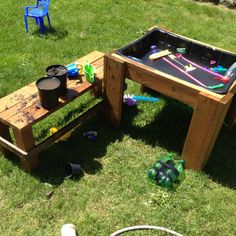 An easy DIY water table (Lowe's $10 cement mixing tray framed in). Sometimes it's a mud table too :)