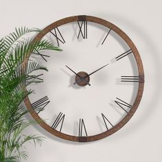 """Bentley Wall #ClockHand-picked by interior designer Elissa Grayer, this eye-catching style brings classic charm and contemporary allure to your home décor.      Product: Clock     Construction Material: Bleached wood and metal     Color: Brown     Accommodates: (1) AA battery - not included     Dimensions: 60"""" Diameter"""