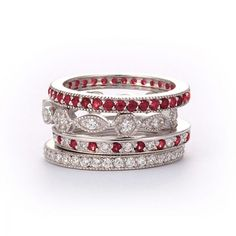 SusanB.flawless Simulated Diamond and Ruby Stackable Bands Set of 4 Rings Sterling Silver  Item # R1MWXX $99.00 Take high fashion to new heights with a stunning stack of gorgeous rings. This four-piece stack ring set features gleaming platinum-plated designs hand set with simulated diamonds and rubies. Wear the rings together, separately, or one at a time for endless fashion possibilities.