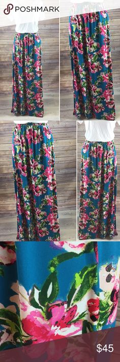 """S-L Stunning Floral Maxi Skirt Super feminine and flirty floral Maxi skirt with beautiful shades of Teal, Hot pink, peach and Kelly green. This is by peach love California and made in USA. 100% Polyester length 40"""" and small fits up to a 28"""" Waist (it's elastic) Skirts Maxi"""