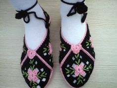 Handmade crocheted womens slippers with pink roses. They are crocheted from the best quality yarns. They are unique and will look sp pretty on