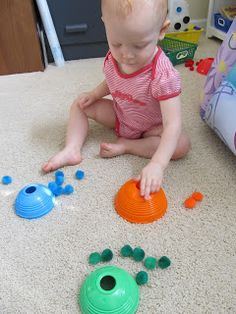 Color Matching Pom-Poms to Fisher-Price Stack & Roll Cups