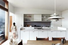 18. A nod to the Nordic philosophy, this kitchen is a low-maintenance marvel. For extra storage, the bench includes a...