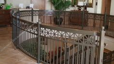 These railings were built and installed by Southeastern Ornamental Iron Co. Inc more than 10 years ago.  http://www.southeasternornamental.com