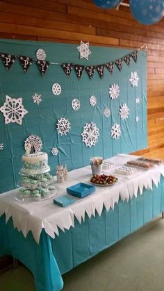 Table cloth and backdrop with snowflakes. Gray banner w/ white letters