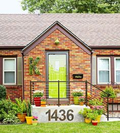 These homeowners updated their 1945 brick bungalow with a bright green door.