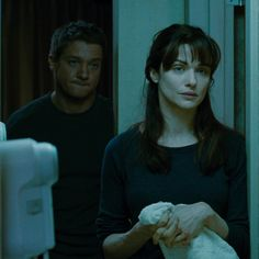 Jeremy Renner as Aaron Cross and Rachel Weisz as Dr. Marta Shearing in The Bourne Legacy