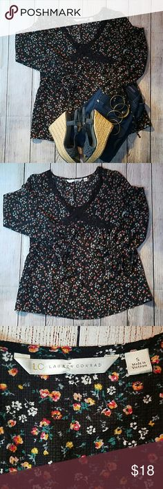 Floral Blouse Adorable and super trendy black floral blouse.  Perfect for spring. Very 70s. Very in right now. Darling lace detailing and ties at the bell sleeves. Cute with jeans and your best Wedges! No wear and tear. Tag says small but could fit a medium. Lauren Conrad Tops Blouses