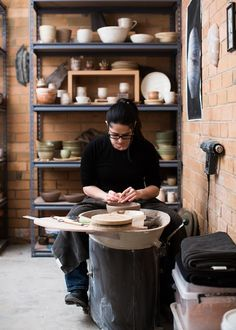 Sarah Schembri working on the wheel in her studio. Photo -Sean Fennessyfor The Design Files.