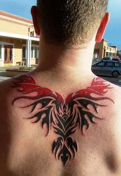 Phoenix Tattoo Upper Back Phoenix tattoo on mans upper